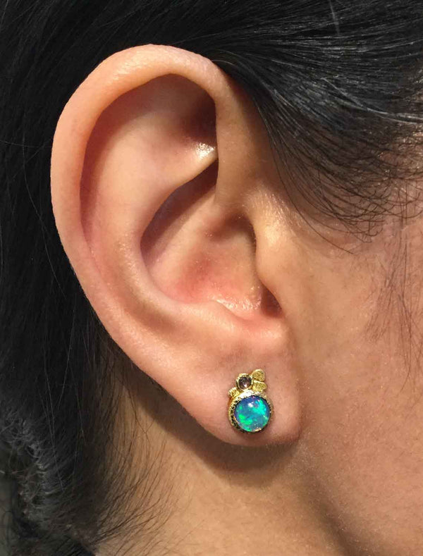 Opal Pebble Stud Earrings on ear
