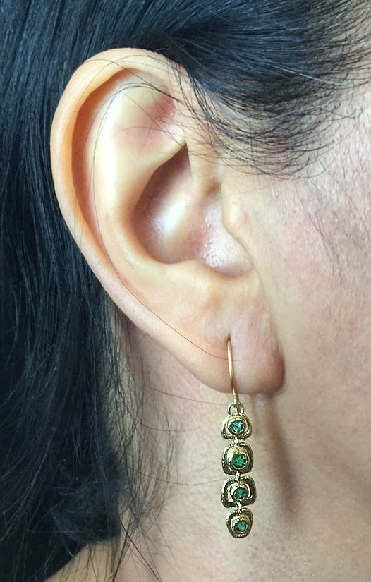 Emerald Open Pebble Dangle Earrings on ear