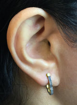 Ripple Hoop Earrings on ear