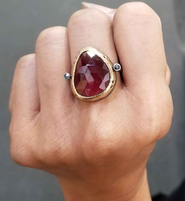 Ancient Pebble Ring with rhodolite on hand