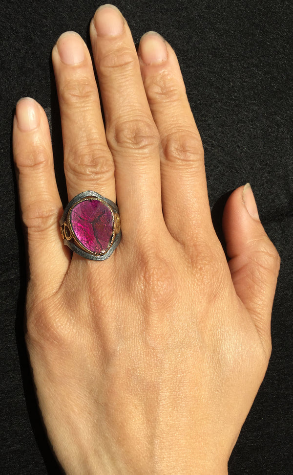 Mountain Stream Ring with rhodolite on hand
