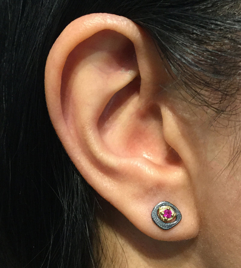 Ruby Stud Earrings on ear