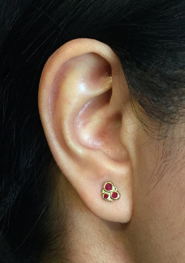 Ruby Cluster Stud Earrings on ear