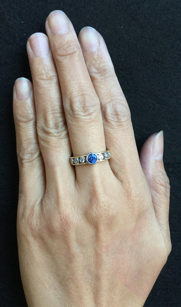 Open Flat Ring with diamonds and sapphire on hand