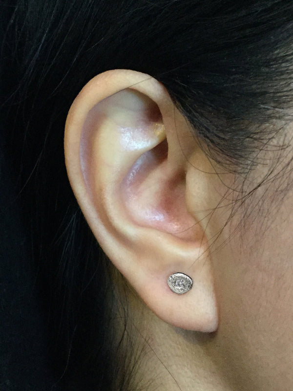 Single Pebble Diamond Stud Earrings on ear