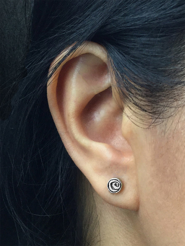 Spiral Stud Earrings in silver on ear