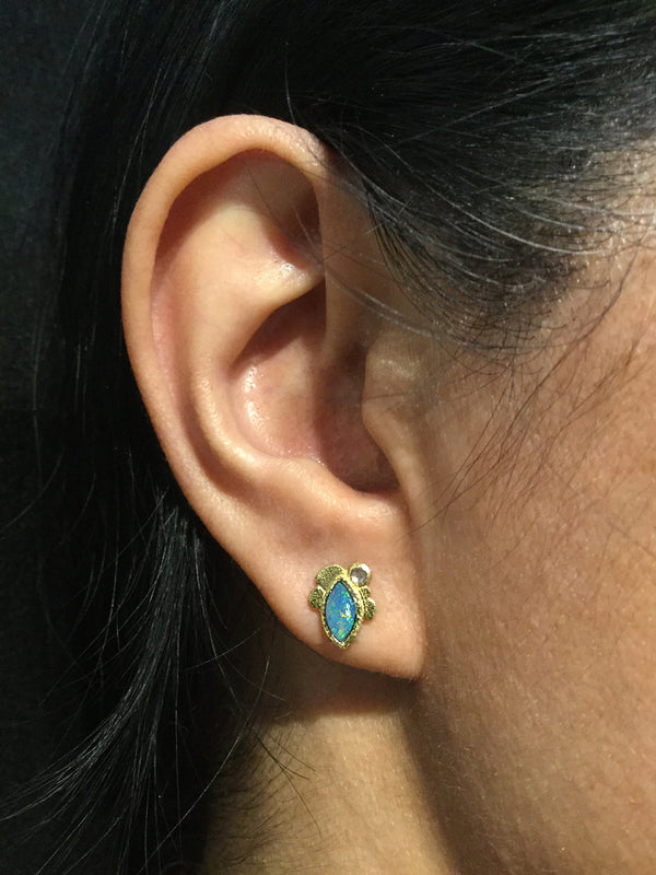 Marquise Opal Stud Earrings on ear
