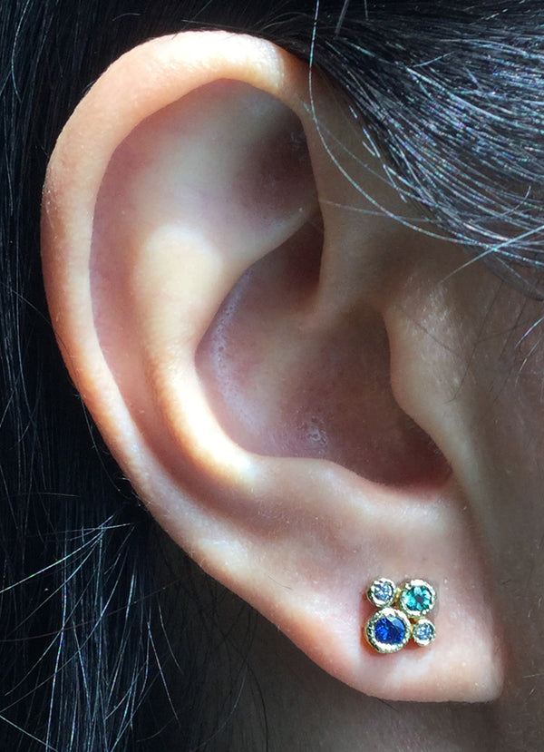 Four Stone Stud Earrings on ear