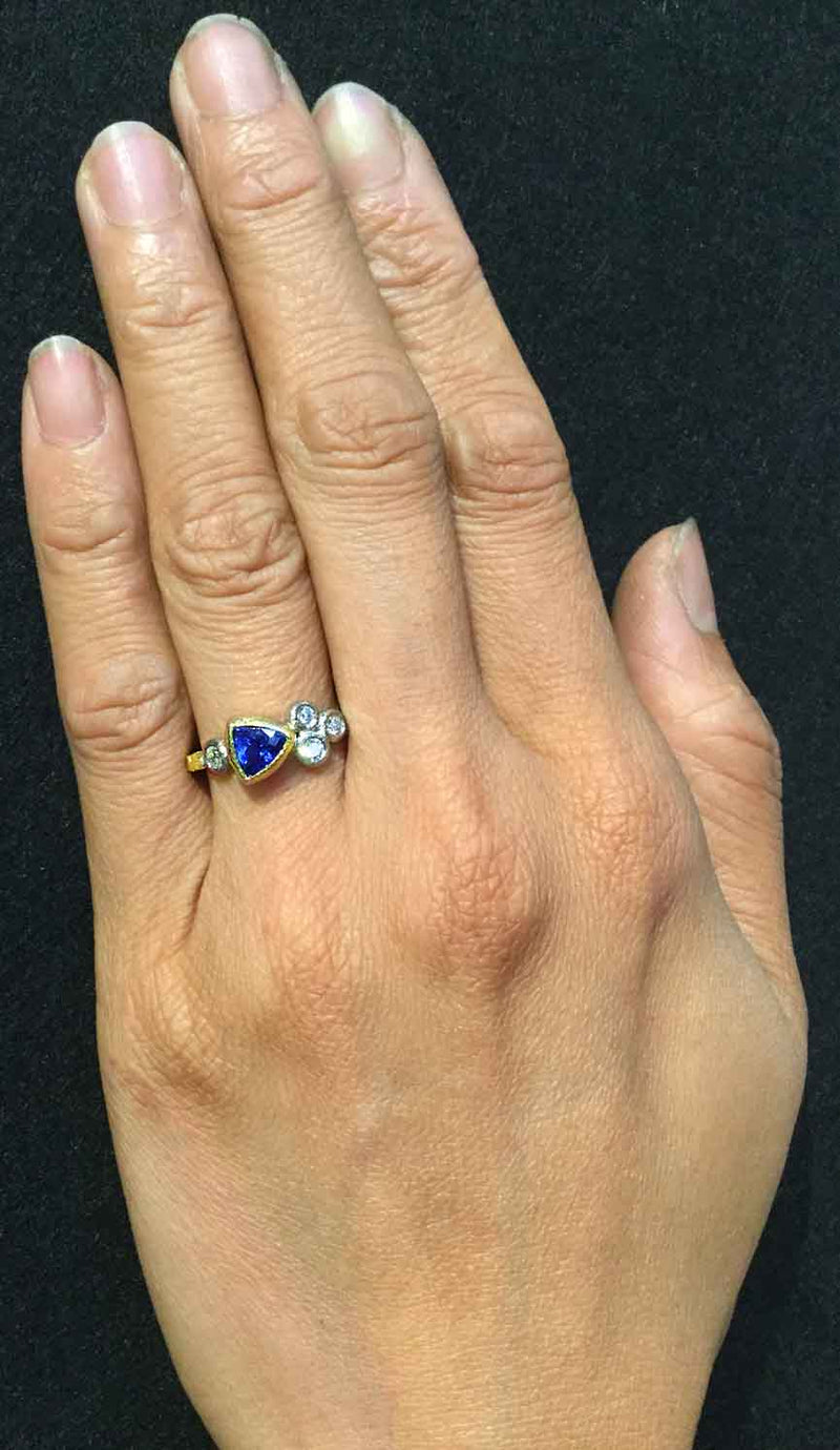 Skinny Pebbles Ring with Trillion Sapphire on hand
