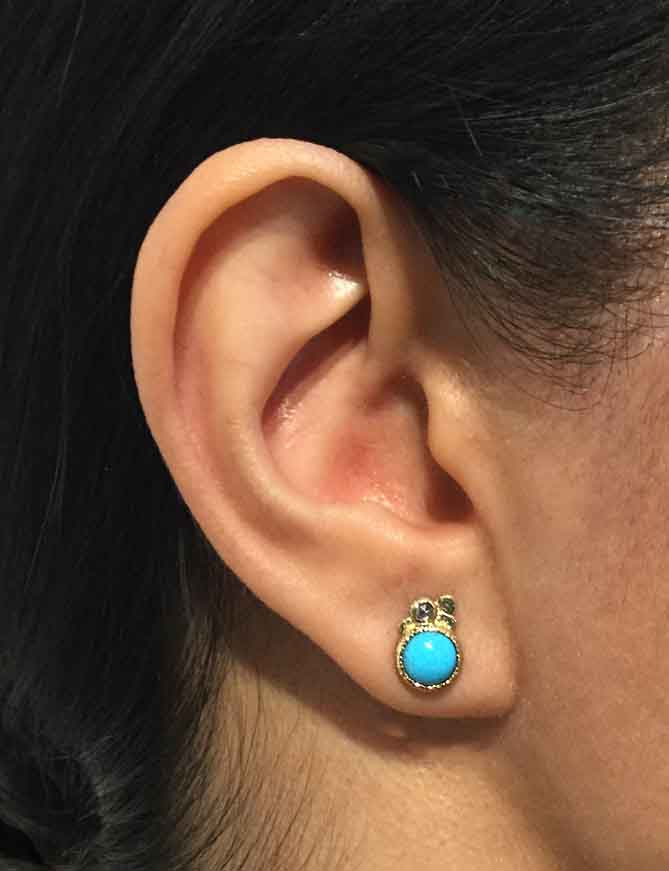 Turquoise Pebble Stud Earrings on ear