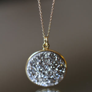 round black druzy pendant on gold filled chain from Songlines by Jewel Handmade Collection