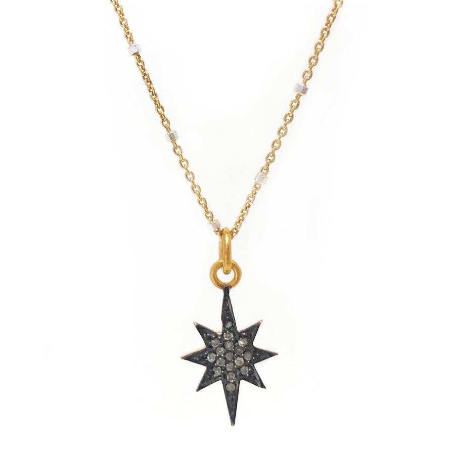 Diamond 8 pointed star charm on gold vermeil chain.
