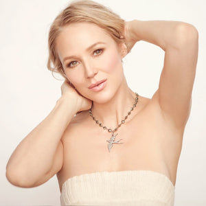 Jewel modeling pave diamond ascension bird necklace from her Songlines Signature Collection