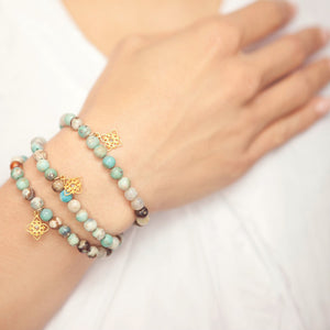 Three blue jasper bead Inspiration bracelets on Jewel's wrist