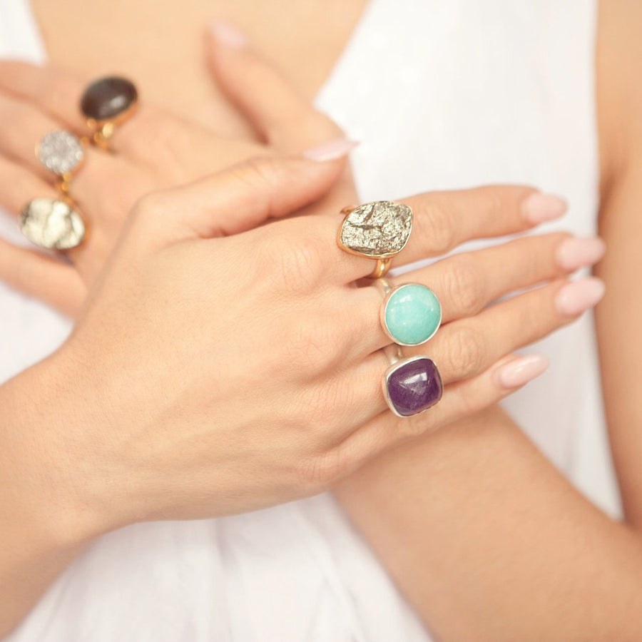 Jewel's hands adorned with rings from her handmade jewelry collection Songlines by Jewel