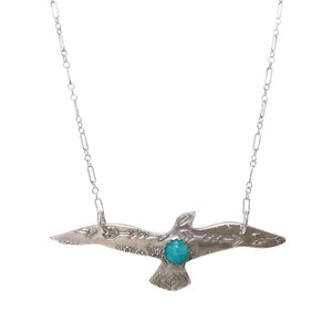 Flying bird pendant w/ amazonite cabochon on a sterling silver chain on white background