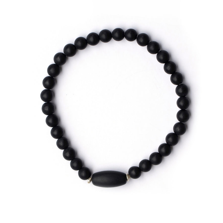 Black jade bead bracelet with sterling silver accents on white backdrop