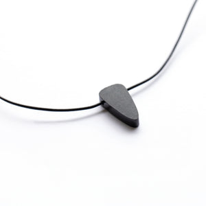 Trillion shaped rare black jade on leather cord
