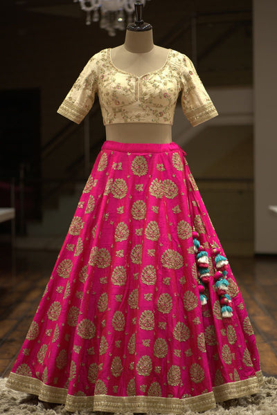 A Cream & Hot Pink Sequins Embroidered Raw Silk Bridal Lehenga