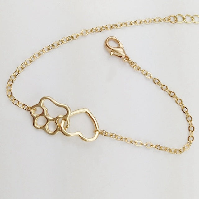 Top Selling Pet Bracelet 2019 New Hollow Pet Paw Footprint Bracelets Dog Love Heart Charm Bracelet For Women or Kids 2019 New Hollow Pet Paw Footprint Bracelets Dog Love Heart Charm Bracelet For Women or Kids
