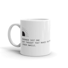 White coffee mug with haiku about lingering thoughts