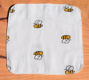 baby handkerchief with bumble bee print laid out on table