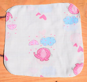 baby handkerchief with elephant print laid out on table