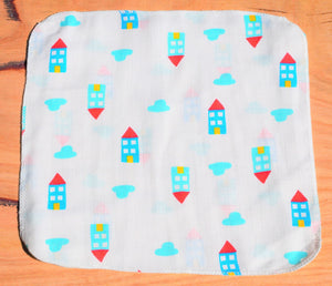 baby handkerchief with houses print laid out on table