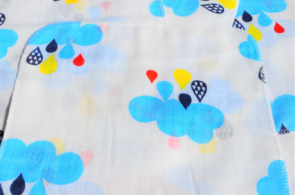 layers of cotton fabric printed with rain clouds