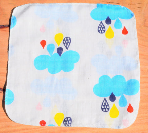 baby handkerchief with rain clouds print laid out on table