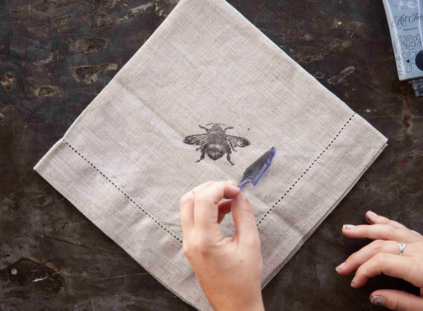Mother's Day is coming up! But don't just grab the same old flowers and generic card. Instead, you can DIY a Mother's Day gift she's sure to love forever. Check out this free tutorial from A Makers' Studio and make a monogrammed linen napkin that's perfect for gifting!