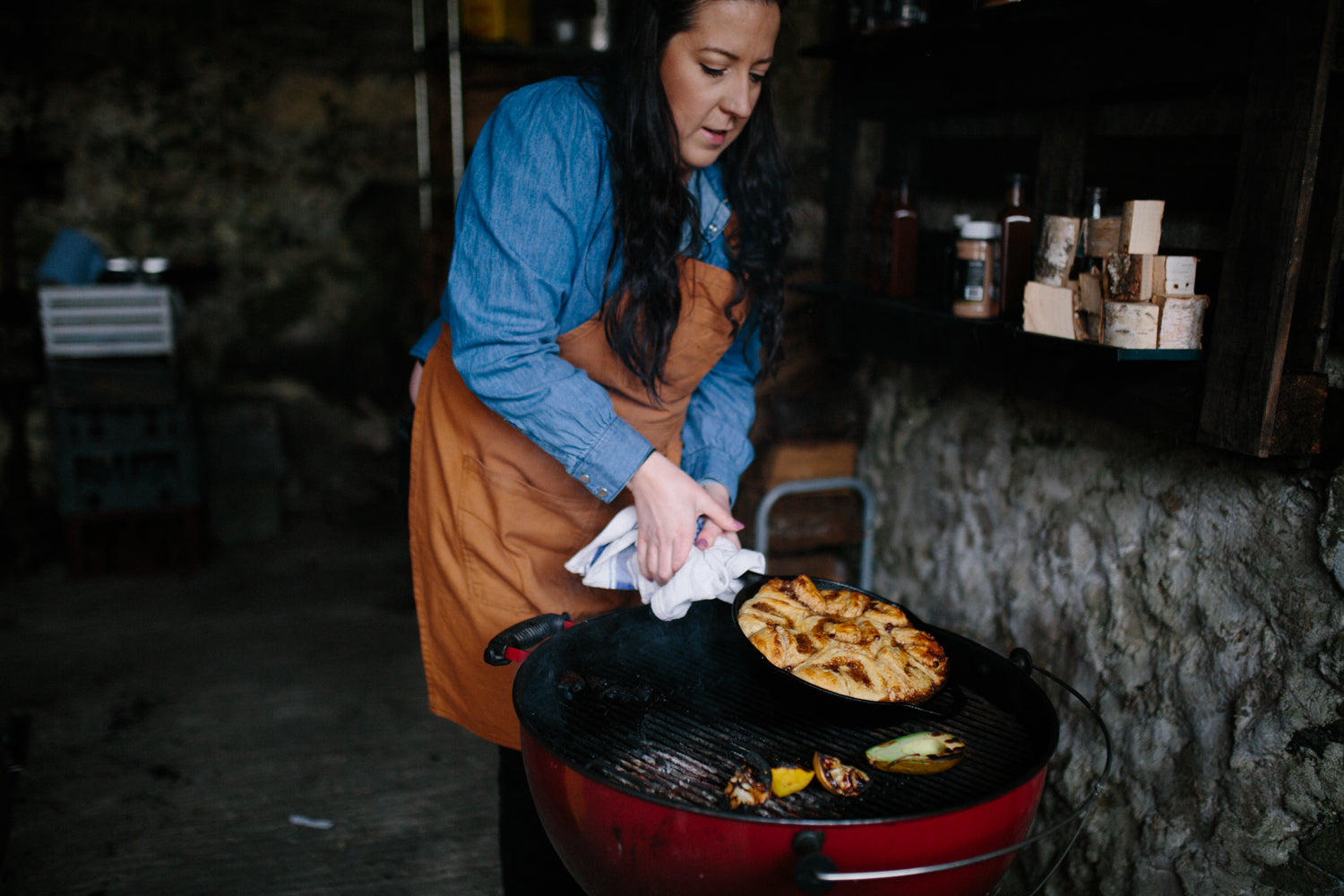 laura holding a cast iron skillet