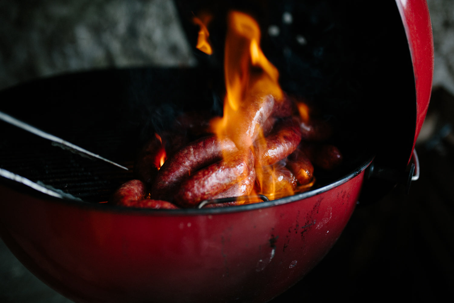 bbq flames and sausages
