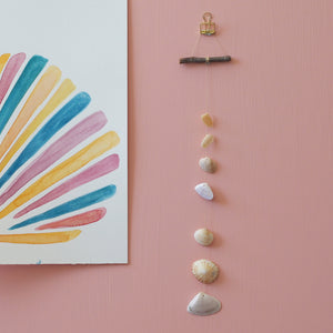 Create a seashell wall hanging