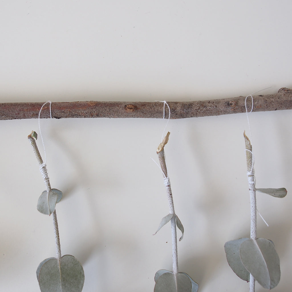 tie leaves to dowel
