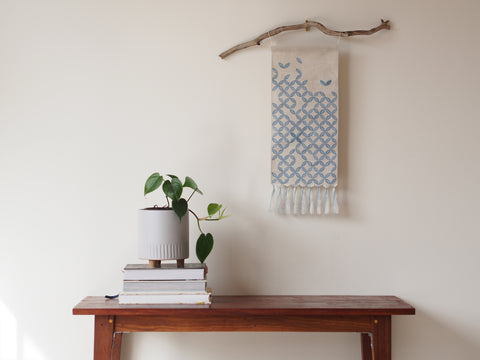 Embroidered linen wall hanging in petal print - limited edition