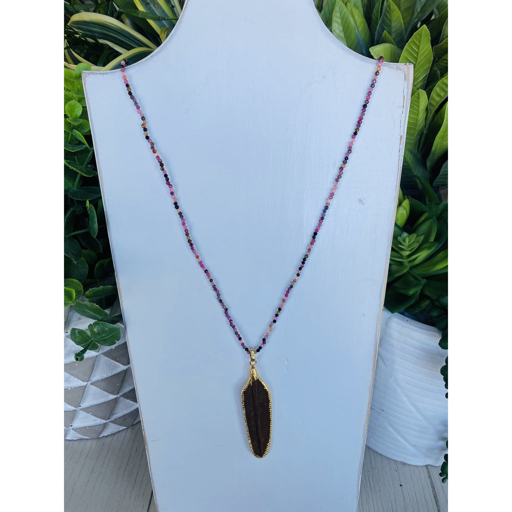 hand carved wooden feather dipped in gold pendent
