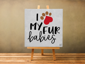 6x6x1 wood panel sign. Painted white background with text - I heart my fur babies. Heart is a paw.