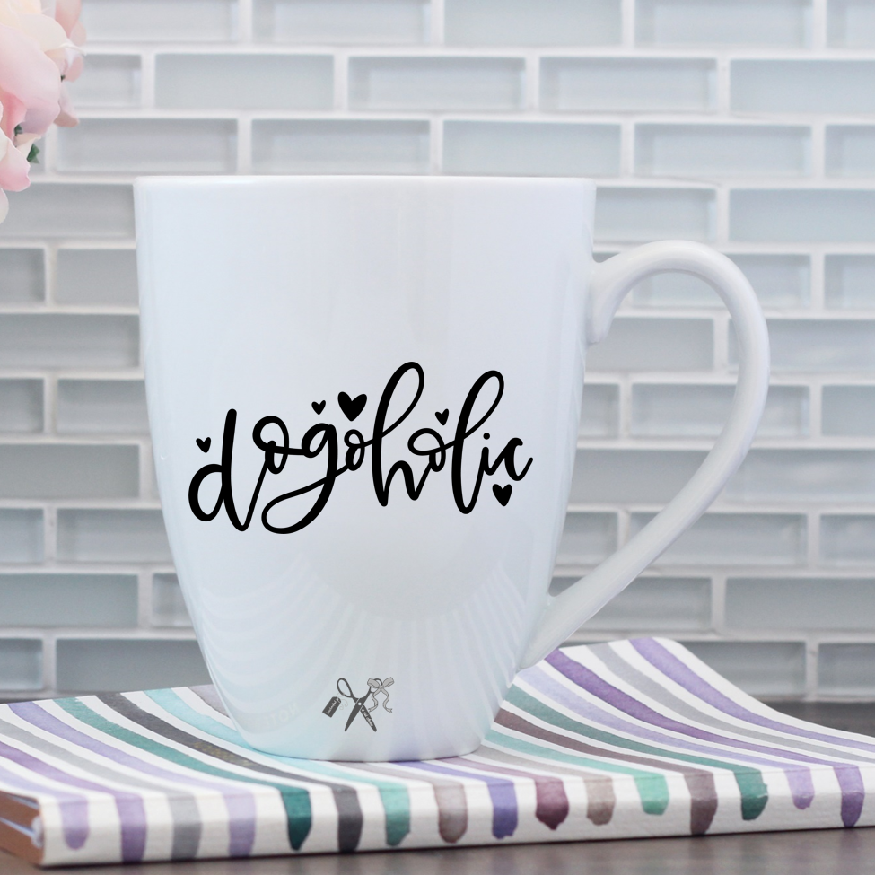 17oz white porcelain mug with black, permanent, premium vinyl applied. Text - dogoholic with little hearts