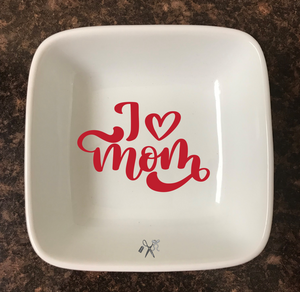 4x4 porcelain square trinket dish. Premium, permanent vinyl applied. Text - I heart mom. Choice of color.