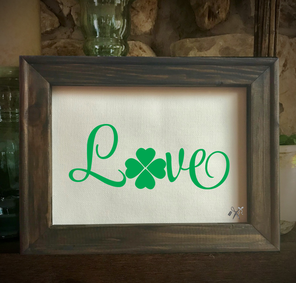 8x10 reverse canvas. Frame is dark walnut stained. Heat transfer vinyl in green, professionally applied with script text - love with a shamrock for the letter o.