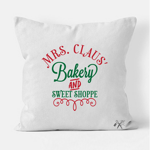 16x16 square, cotton, white pillow cover. Heat transfer vinyl professionally applied. Text - Mrs. Claus' bakery and sweet shoppe in red and green.