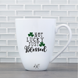 17oz white porcelain mug with black, permanent, premium vinyl applied. Text - Not lucky just blessed with green shamrocks.