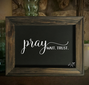 8x10 reverse black canvas. Frame is dark walnut stained. Heat transfer vinyl in white, professionally applied with text - pray, wait, trust.