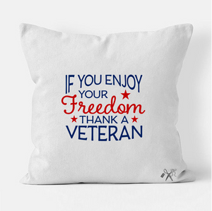 16x16 square, cotton, white pillow cover. Heat transfer vinyl professionally applied. Text - If you enjoy your freedom thank a veteran in blue and red with stars.