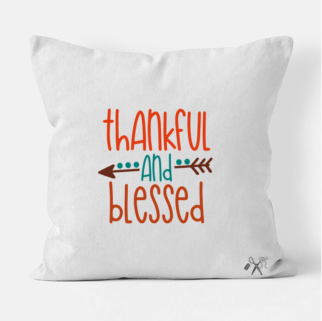 16x16 square, cotton, white pillow cover. Heat transfer vinyl professionally applied. Text - thankful and blessed in orange, teal and brown. Boho design.