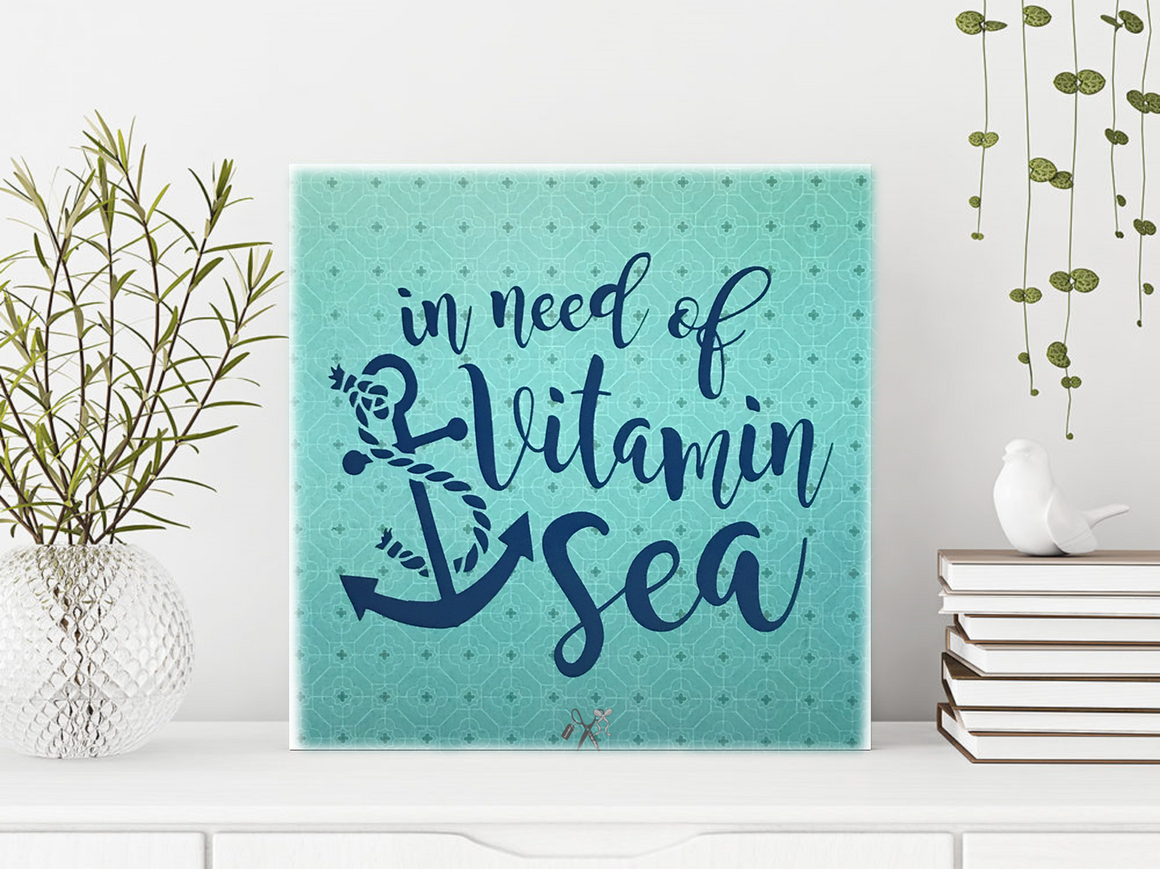 6x6x1 wood panel sign. Blue green background with blue script text - In need of vitamin sea with an anchor.