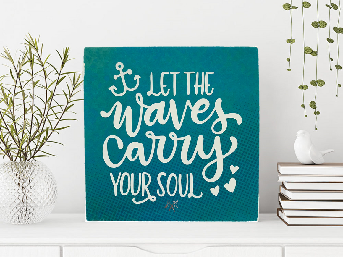 6x6x1 wood panel sign. Deep blue green background with text - Let the waves carry your soul with anchor and hearts.