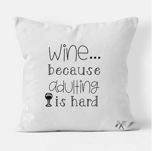16x16 square, cotton, white pillow cover. Heat transfer vinyl professionally applied. Text - wine...because adulting is hard in black.