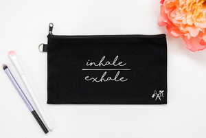 5x8 black cotton makeup bag. White text - inhale/exhale